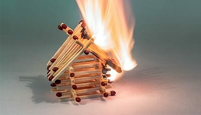 House made of matches lit on fire
