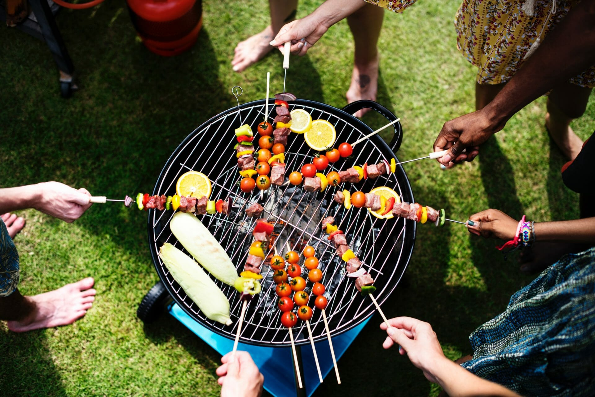 skewers over outside grill at a barbeque